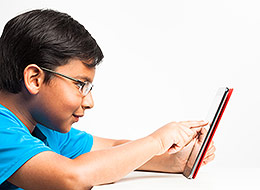Photo of child playing on a tablet